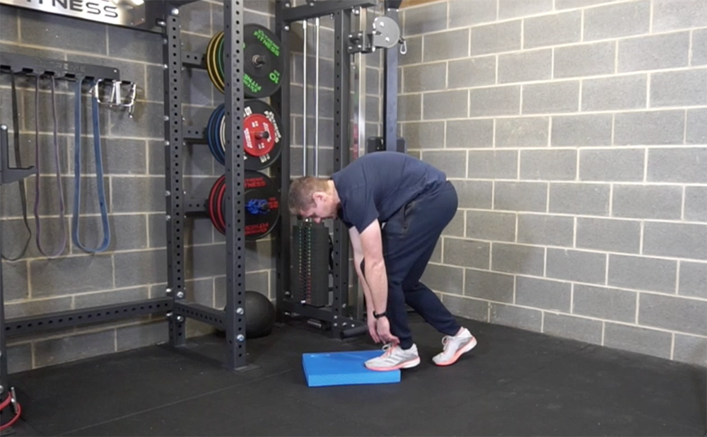 Using the slouch position to achieve thoracic flexion